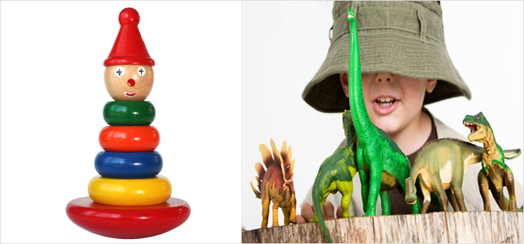 Wooden toy and a boy playing dinosaurs 749px.jpg